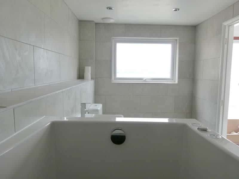 The bathroom window overlooks Morecambe Bay